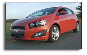 2012 Chevrolet Sonic LTZ Turbo, Inferno Orange Metallic, 3/4 front view
