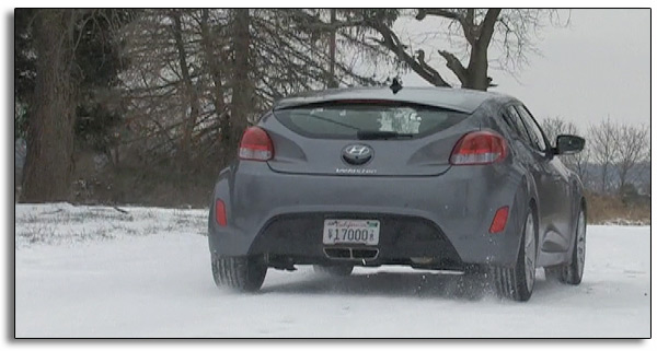 2012 Hyundai Veloster - rear view - snowy road