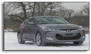 2012 Hyundai Veloster - 3/4 front view - snowy road