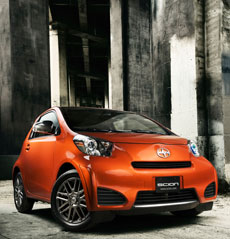 Orange Scion IQ in an industrial setting